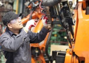 Maintenance technician repairing machine